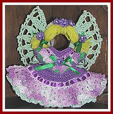 Violet the Easter Angel is crocheted on a gingerbread man cookie cutter base.