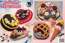 Annie's Attic Crochet Sweet Dreams contains patterns for crochet Chocolate Cake, Ice Cream Cone, Box of Candy, Blackberry Pie, Banana Split, and Plate of Cupcakes.
