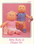 Annies Attic Bitty Baby is a 12-inch crocheted soft sculpture doll.