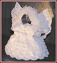 Aunt Irma's Snow Angel is crocheted in white pearlized cotton thread on a cookie cutter base.