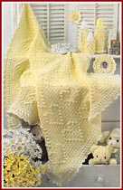 You Are My Sunshine baby afghan and nursery set, including musical bottle cover.